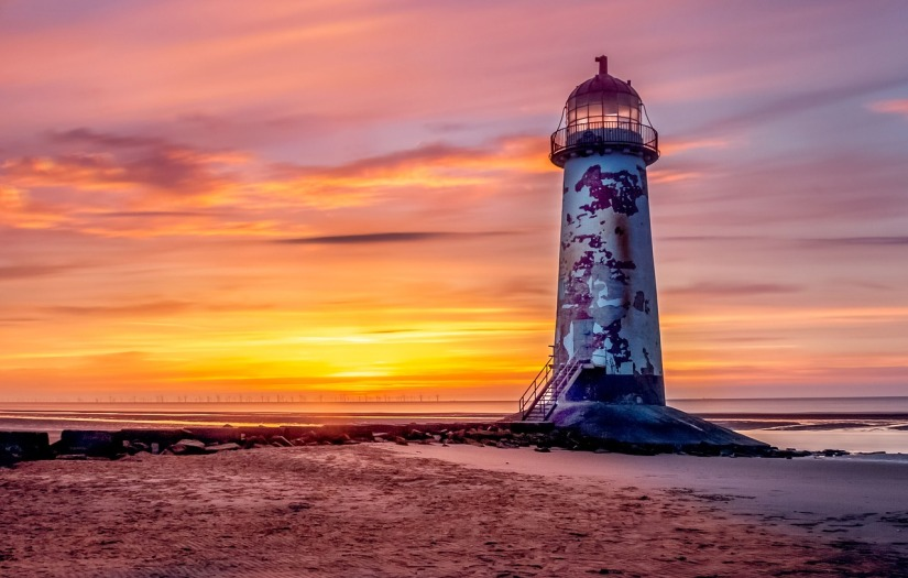 Lighthouse at sunset by DaBrick via pixabay